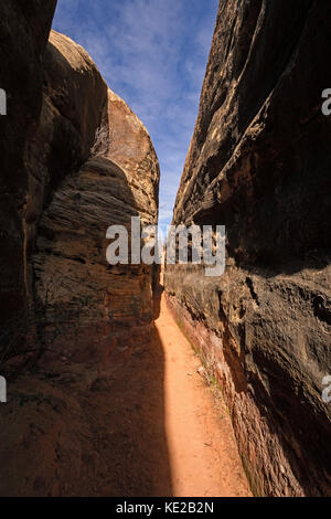 Narrow Canyon Trail in the Desert of Canyonlands National Park in Utah - Stock Photo