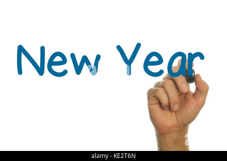 Hand writing the word NEW YEAR  in Blue on Screen - Stock Photo