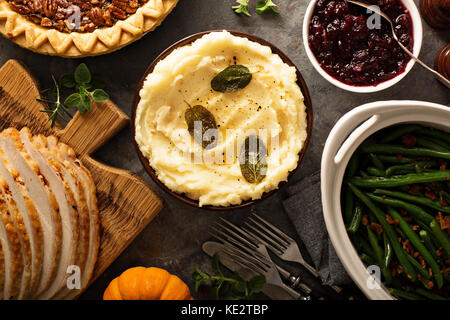 Mashed potatoes with butter and sage, side dish for Thanksgiving or Christmas dinner overhead shot - Stock Photo