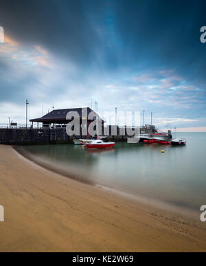 Fishing boats at sunrise at Viking Bay in Broadstairs, Kent - Stock Photo