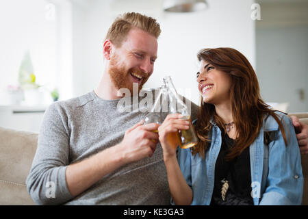 Young beautiful couple flirting and smiling at home - Stock Photo