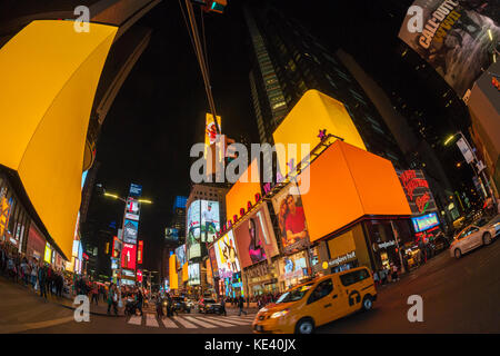 New York, USA. 18th Oct, 2017. Giant led screens in Times Square in New York go orange as a ploy to attract Amazon's - Stock Photo