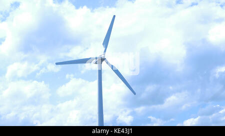 Beautiful sunset above the windmills on the field. Windmill against blue sky with motion in blades. Beautiful sunset - Stock Photo