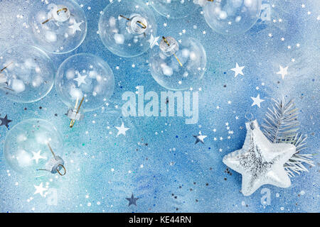 christmas background with silver star confetti on brushed metal