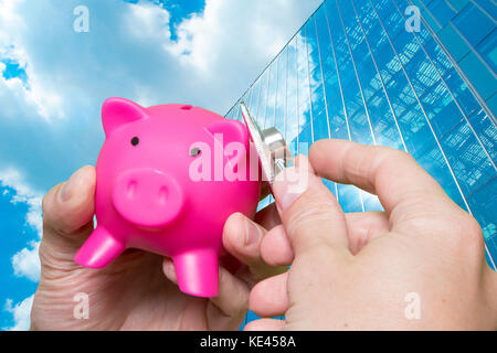 Man hand stethoscope pink piggy bank Isolated on white background. Health care cost. Financial state condition self - Stock Photo