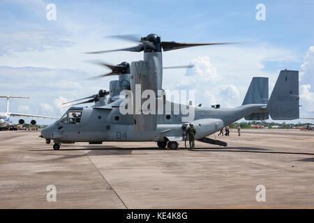 Bell Boeing V-22 Osprey, rotors running refuel at an airport, united states marines corp - Stock Photo