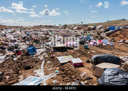 Piles of household refuse in dumping area at local tip - Stock Photo