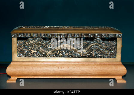 RUSSIA, SOCHY - september 27, 2017: Eastern wooden box (censer) with a cast bronze inset depicting the Chinese dragon - Stock Photo