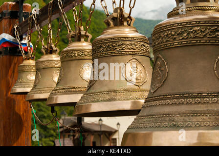 RUSSIA, SOCHY - september 27, 2017: row of traditional Orthodox bells of different sizes in the bell gable - Stock Photo