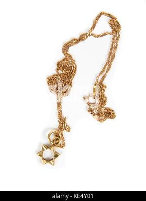 Magen David gold necklace closeup - Stock Photo