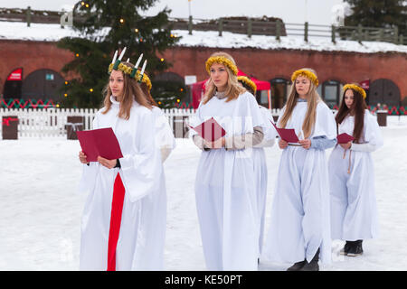 Hamina, Finland - December 13, 2014: choir of Finnish girls goes to the Christmas fair in Hamina - Stock Photo