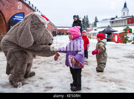 Hamina, Finland - December 13, 2014: Christmas fair in Hamina bastion, animators in animal costumes play with children - Stock Photo