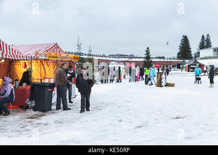 Hamina, Finland - December 13, 2014: Christmas fair in Hamina bastion, ordinary people and tourists walk on town - Stock Photo