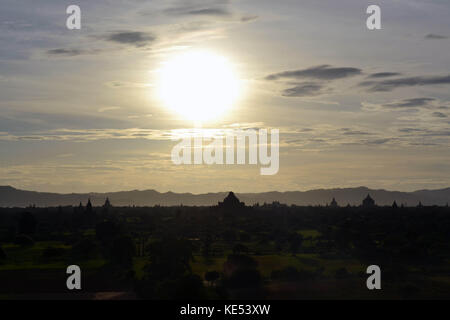 Sunset around temples that scattered in Bagan Archaeological Zone, Myanmar. It's a UNESCO world heritage. Pic was - Stock Photo