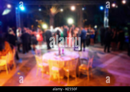 Blurred background of night dancing party  in a restaurant outdoor - Stock Photo