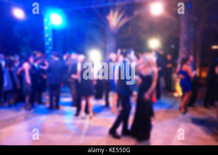 Blurred background of night dancing party outdoor - Stock Photo