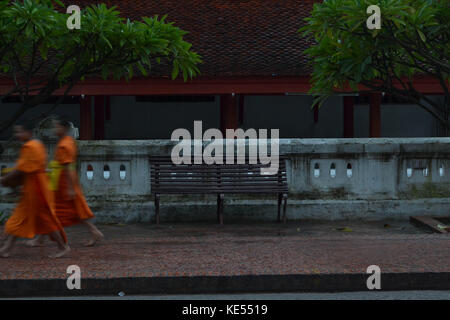 The ritual of alms giving (the monks collecting alms) in Luang Prabang, Laos. Pic was taken in August 2015. - Stock Photo