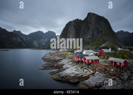 Traditional red rorbu cottages in Hamnoy village, Lofoten islands, Norway - Stock Photo