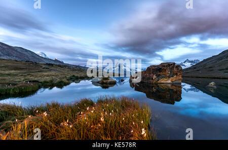 Matterhorn reflected in the Stellisee, Zermatt, Valais Alps, Canton Valais, Switzerland - Stock Photo