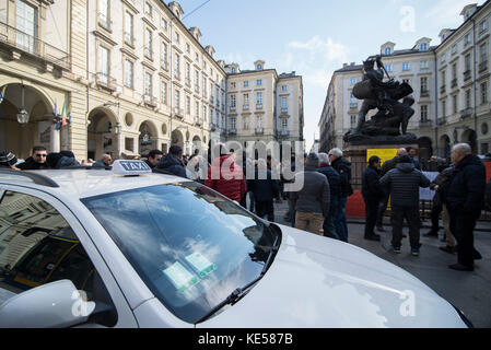 Turin,Italy February 16, 2017: Taxi drivers protest in Turin against Uber and new laws on Palazzo Civico and Piazza - Stock Photo