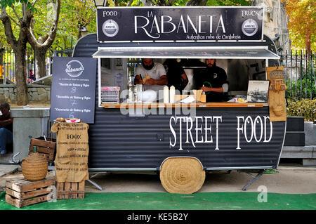 Street food caravan on a fair in San Lorenzo de El Escorial, Madrid. - Stock Photo