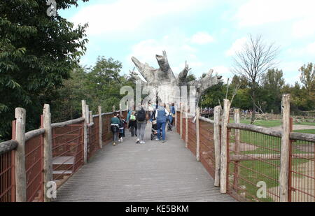 People visiting Rotterdam Blijdorp  zoo, The Netherlands, Wooden bridge along the Savannah area with artificial - Stock Photo
