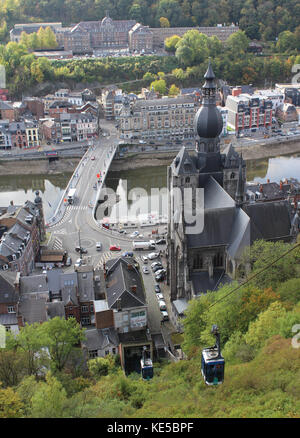 DINANT, BELGIUM, OCTOBER 13 2017: View from the citadel down to the Meuse River and Our Lady's Church in Dinant, - Stock Photo