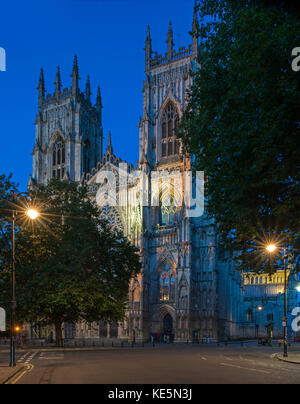 The illuminated West Facade of York Minster - Stock Photo