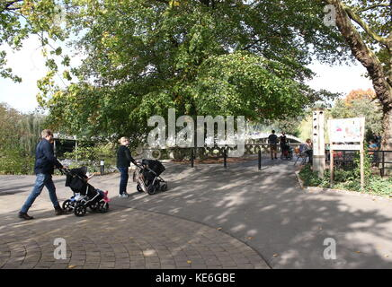 Family with buggies visiting Rotterdam Blijdorp  zoo, The Netherlands. - Stock Photo