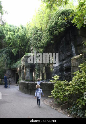 People visiting Rotterdam Blijdorp  zoo, The Netherlands. Girl walking alone, seen from behind. - Stock Photo