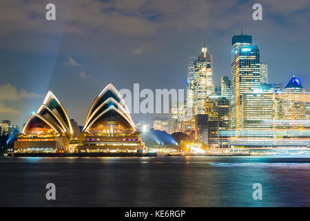 Sydney Opera House and CBD at night - Stock Photo