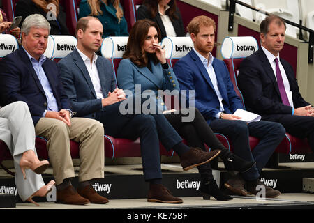 Sir Keith Mills (left) chairman of the Royal Foundation sits with the Duke and Duchess of Cambridge and Prince Harry - Stock Photo