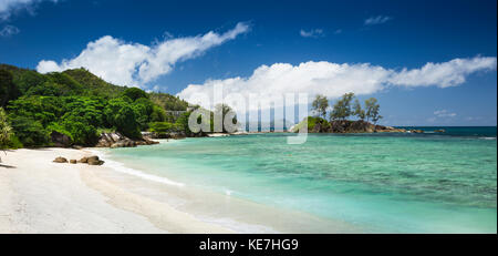 The Seychelles, Mahe, Port Glaud, beach and Abandoned Seychelles National Youth Service camp panoramic - Stock Photo