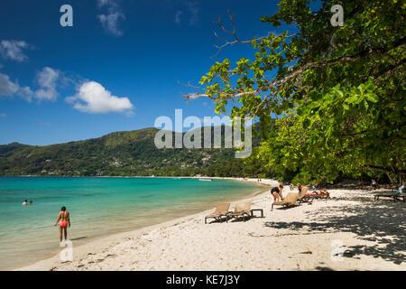 The Seychelles, Mahe, Beau Vallon, tourists on beach outside H Resort - Stock Photo