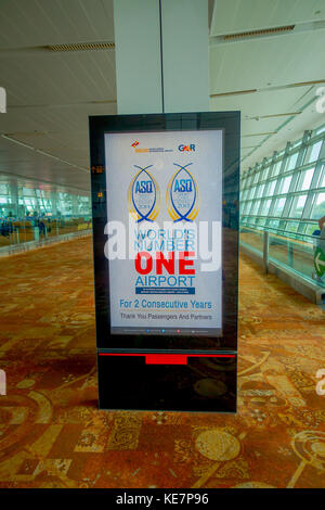 DELHI, INDIA - SEPTEMBER 19, 2017: Informative sign in an automatic screen of world s number one airport two consecutive - Stock Photo