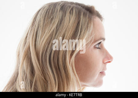 Profile Of A Woman's Face With Blond Hair; Connecticut, United States Of America - Stock Photo