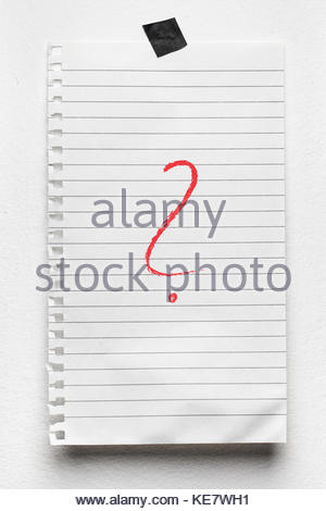 Red color question mark symbol handwriten on notepad. - Stock Photo