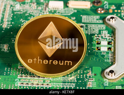 Ethereum coin on a printed circuit board - Stock Photo