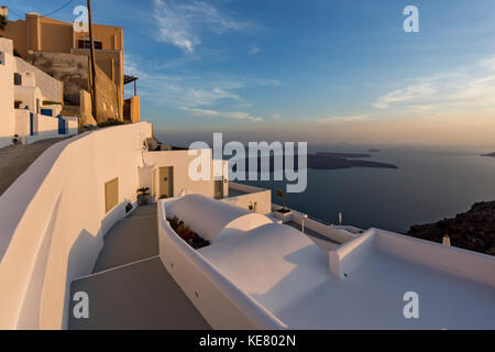 Panoramic view of Santorini island and Sunset over town of Imerovigli, Thira, Cyclades, Greece - Stock Photo