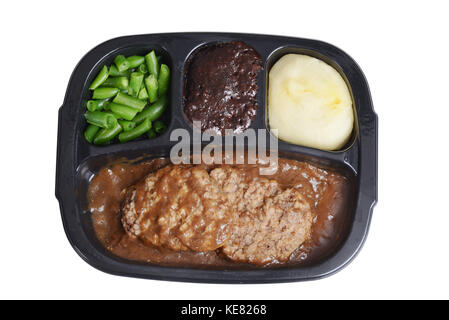 isolated salisbury steak tv dinner with brownie - Stock Photo