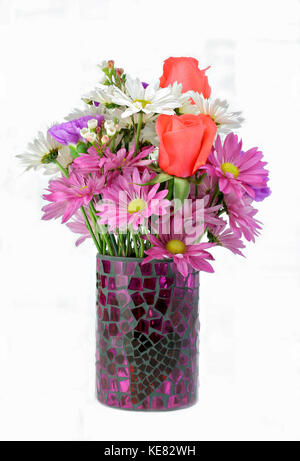 Beautiful assorted flowers in a vase isolated on white with copy space. - Stock Photo