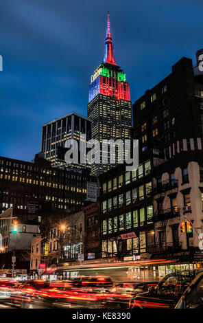 Empire State Building In Christmas And Hanukkah Colours; New York City, New York, United States Of America - Stock Photo