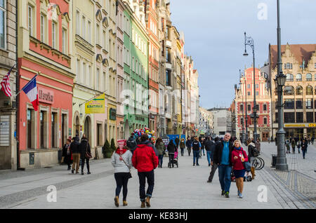 Main Market Square With Old Buildings And People Strolling; Wroclaw, Lower Silesia, Poland - Stock Photo