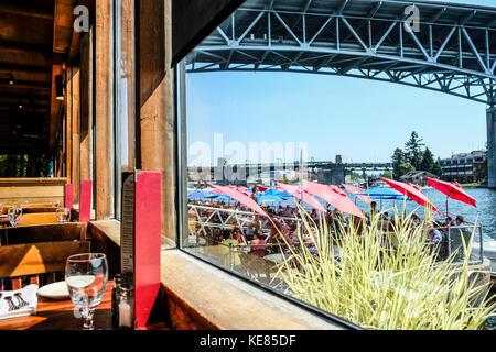 Seattle Lake Union and ship canal bridge seen through Ivar's Seafood Restaurant - Stock Photo
