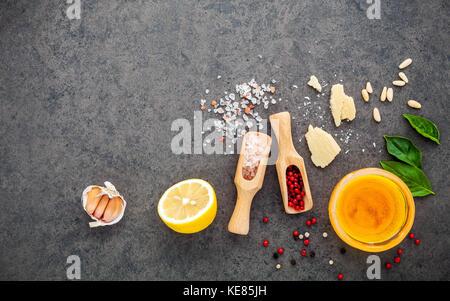 The ingredients for homemade pesto sauce basil, parmesan cheese ,garlic, olive oil , lemon ,pine nut ,pepper corn - Stock Photo