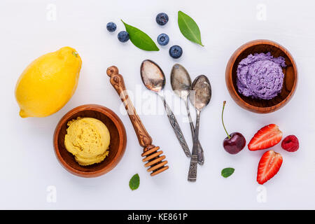 Flat lay ice cream with various fruits raspberry ,blueberry ,strawberry ,lemon and cherry  setup on white background - Stock Photo