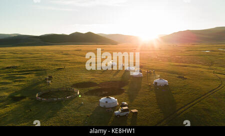 Aerial view of family gers in late afternoon sun. Khuvsgol, Mongolia. - Stock Photo