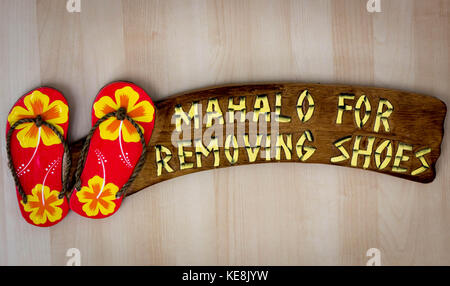 Sweet Hawaiian Sign: Mahalo for removing your slippers - Thank you for taking off shoes - Stock Photo