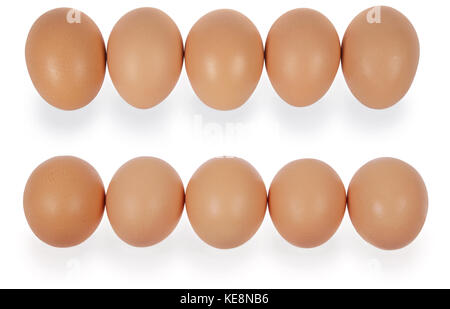 Five eggs in row. Isolated on a white background. Clipping path inside. - Stock Photo