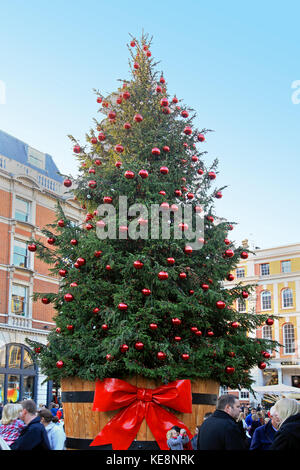 London, United Kingdom - November 19, 2011; Large Christmas tree outside on Covent Garden square in London during - Stock Photo